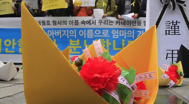Paper ships to pay tribute to the victims and missing passengers of the sunken ferry Sewol in Seoul, South Korea (AP)