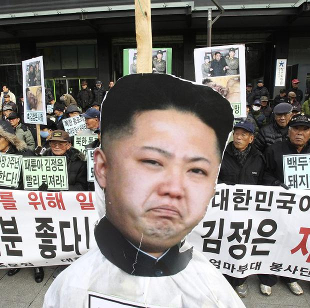 A portrait of North Korean leader Kim Jong Un is displayed during an anti-North Korea rally in Seoul (AP)