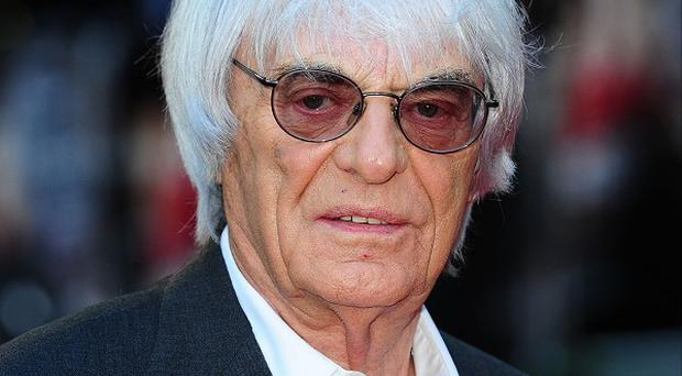 Bernie Ecclestone says he was blackmailed into making a multimillion-pound payment to a German banker