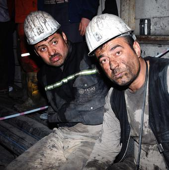 Two miners after being rescued hours after an explosion and fire at a coal mine in Turkey (AP)