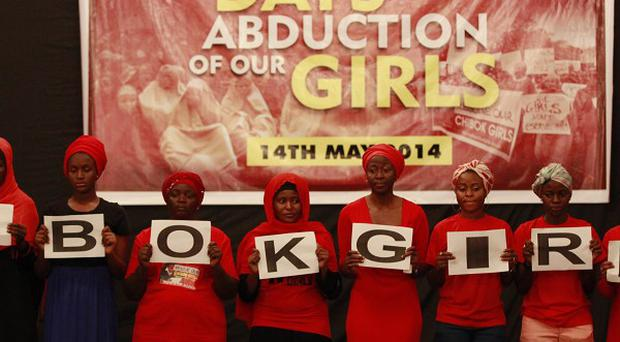 People attend a vigil in Abuja to mark one month after the Nigerian schoolgirls were kidnapped (AP)