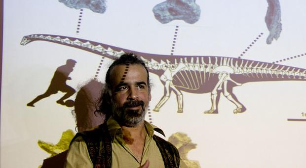 Paleontologist Sebastian Apesteguia speaks to the press about a newly discovered dinosaur discovered in Argentina (AP)