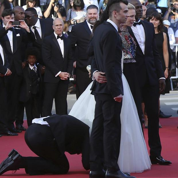 A man who ran onto the red carpet crawled under the dress of actress America Ferrera (AP)