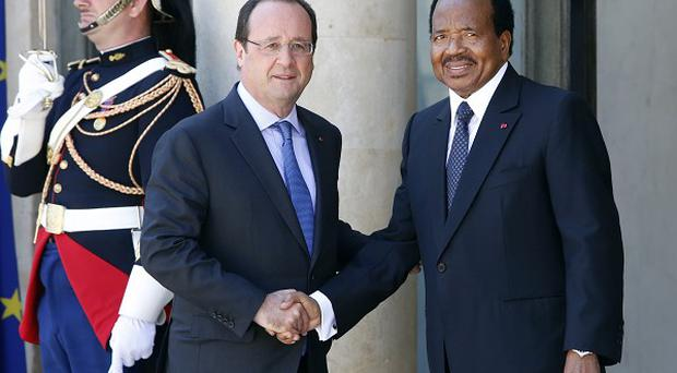 French president Francois Hollande welcomes Cameroon president Paul Biya to the summit (AP)