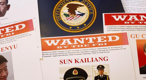 Wanted posters featuring those facing US cyber-espionage charges (AP)