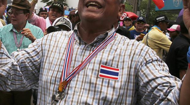 Anti-government protest leader Suthep Thaugsuban is greeted by supporters in Bangkok shortly before the army declared martial law (AP)