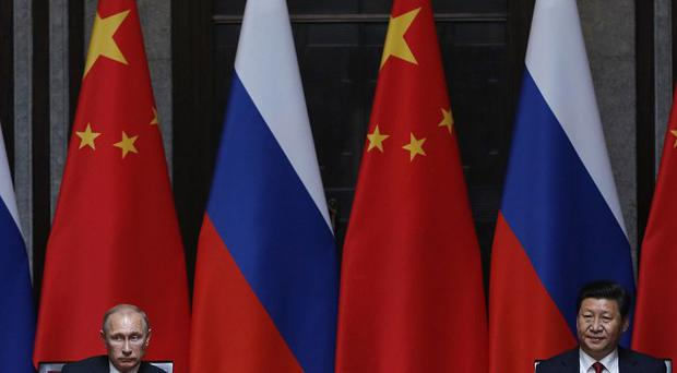 Russia's President Vladimir Putin, left, and his Chinese counterpart Xi Jinping (AP)