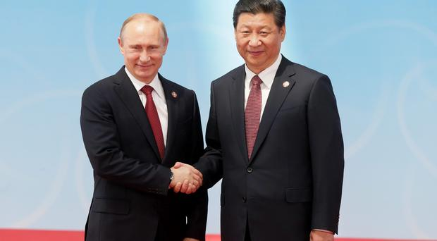 Russia's President Vladimir Putin seals the deal with China's President Xi Jinping (AP)