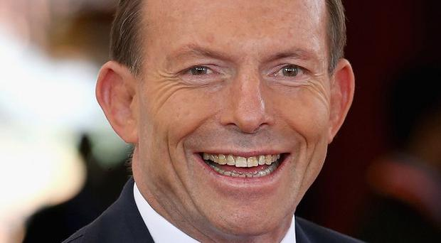 Australian prime minister Tony Abbott has admitted he made a mistake by winking and smiling during a sex worker's call to a radio station show