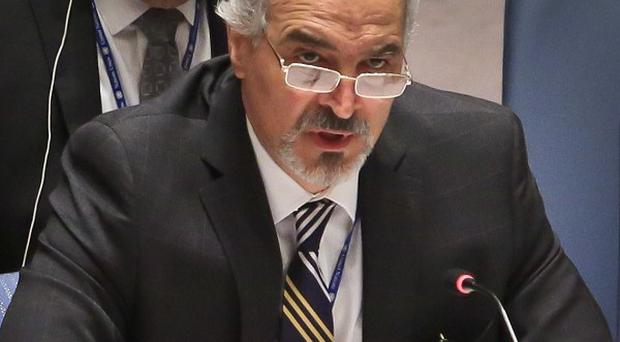 Syrian UN ambassador Bashar Ja'afari speaks after a Security Council vote on referring the Syrian crisis to the International Criminal Court (AP)