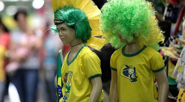 Brasilia gets ready for the World Cup with mannequins in national football regalia (AP)