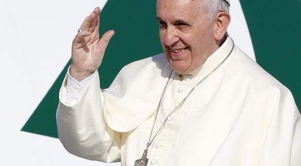 Pope Francis waves as he boards a plane to Amman, Jordan (AP)