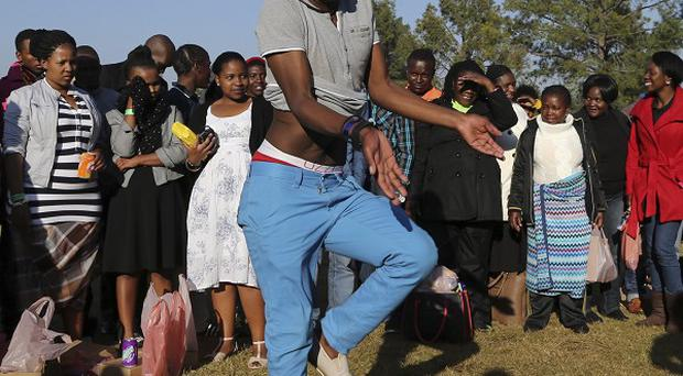 A man dances at Union Building in Pretoria, South Africa, ahead of the inauguration ceremony of President Jacob Zuma for a second term (AP Photo/Themba Hadebe)