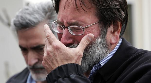 Richard Martinez whose son Chris was killed in the mass shooting, breaks down as he talks to the media (AP)