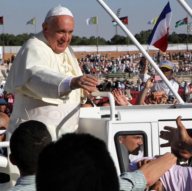 Pope Francis after his arrival at Amman's international stadium in Jordan (AP)