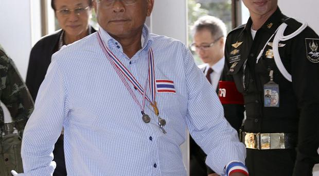 Anti-government protest leader Suthep Thaugsuban arrives at the attorney general's office in Bangkok to hear his insurrection charge (AP)