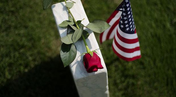 A rose sits on a tombstone of a civl war soldier at Marietta National Cemetery on Memorial Day (AP)