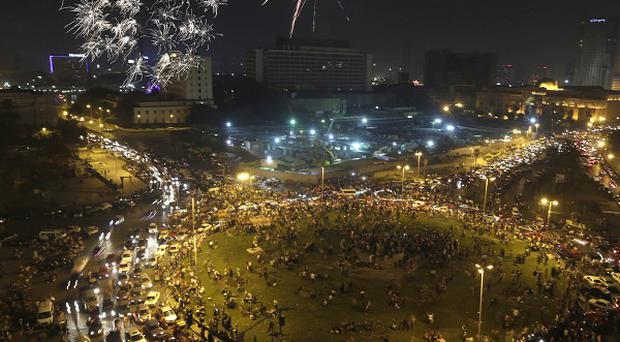 Fireworks explode as supporters of Abdel-Fattah el-Sissi celebrate at Tahrir Square in Cairo (AP)
