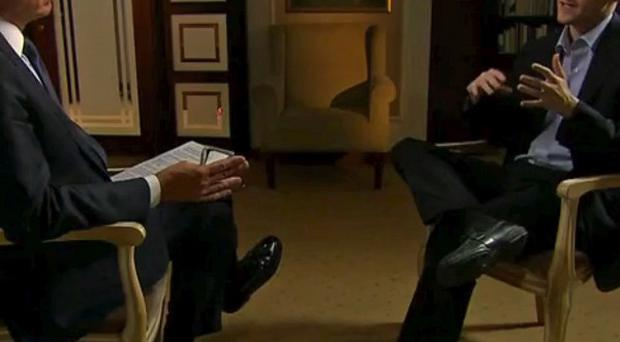 Edward Snowden, right, speaks to Brian Williams during an NBC Exclusive interview (AP/NBC News)