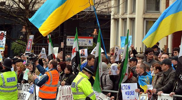 British-based Ukrainians gather outside the Russian Embassy in London to protest against the build-up of troops in the Crimea region