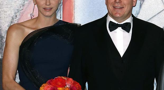 Prince Albert II of Monaco and his wife Princess Charlene are expecting a baby (AP Photo)