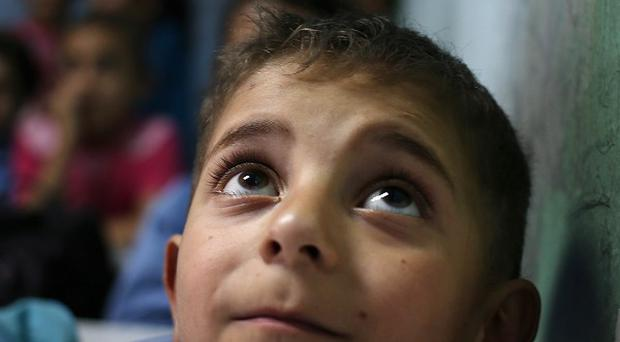 Syria's conflict has killed more than 160,000 people and caused a humanitarian crisis