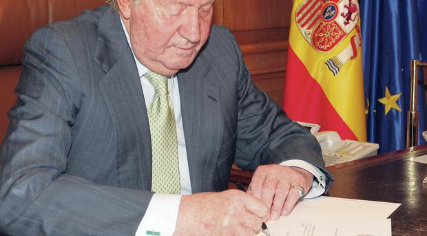 Juan Carlos signs the papers of abdication in Madrid. He will be succeeded by Crown Prince Felipe