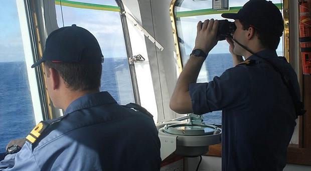 The crew on board survey ship HMS Echo search for the missing Malaysia Airlines jet in the southern Indian Ocean (MoD/PA)