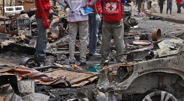 Boko Haram militants are reported to have killed at least 200 in villages in north-east Nigeria (AP)