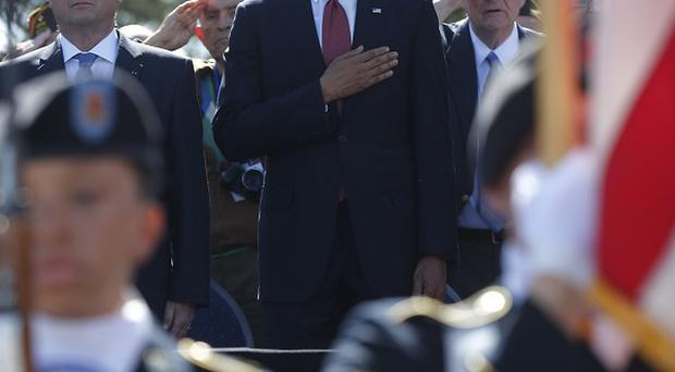 US president Barack Obama and French president Francois Hollande pay tribute to D-Day heroes at Omaha Beach (AP)