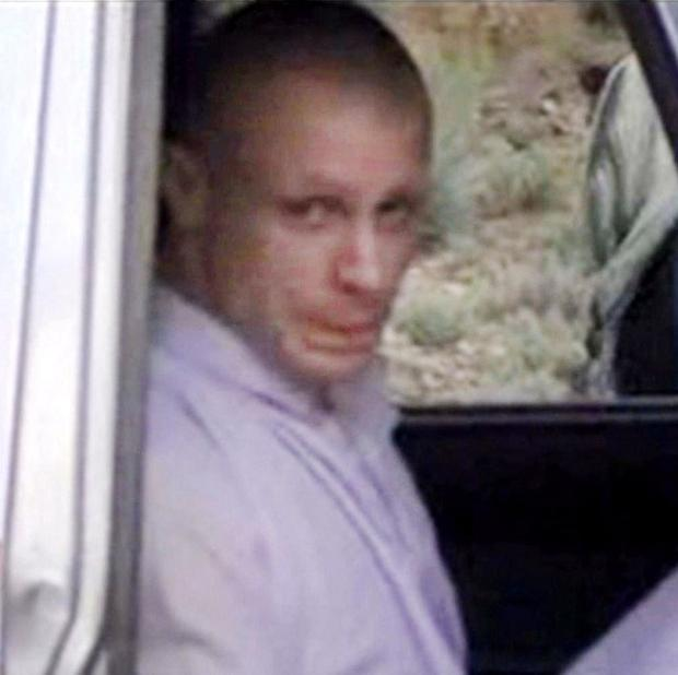 A video image shows Sgt Bowe Bergdahl in a vehicle guarded by the Taliban in eastern Afghanistan (AP/Voice Of Jihad Website)