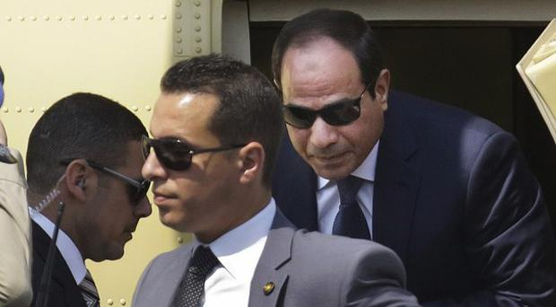 Abdel-Fattah el-Sissi gets out of a military helicopter as he arrives at the Supreme Constitutional Court to take the oath of office in Cairo, Egypt (AP)