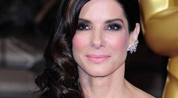 An intruder was arrested at the home of Sandra Bullock while the actress was there