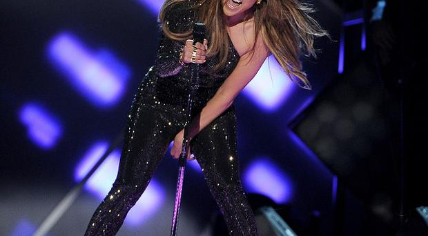 Jennifer Lopez won't perform the World Cup song at the opening ceremony in Brazil (AP)