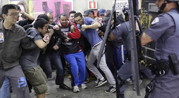 Subway train operators, along with some activists, clash with police at the Ana Rosa metro station in Sao Paulo, Brazil (AP)