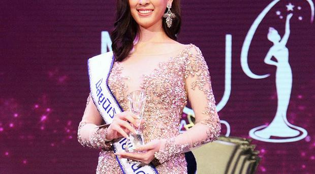 Weluree Ditsayabut poses after she was crowned Miss Universe Thailand (AP)