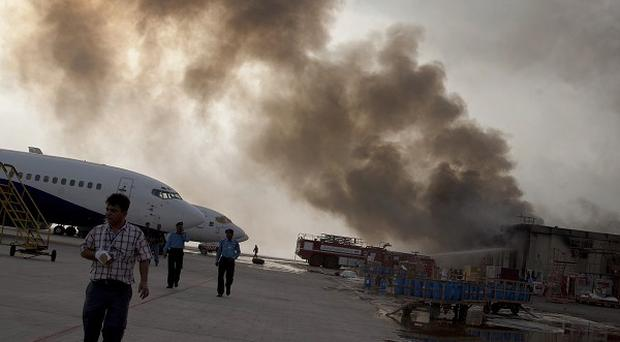 More bodies have been found after a Taliban attack on Karachi International Airport (AP Photo/Shakil Adil)