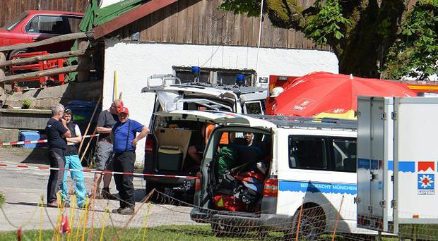 Rescuers are working to recover a man stuck deep inside a cave in the German Alps (AP)