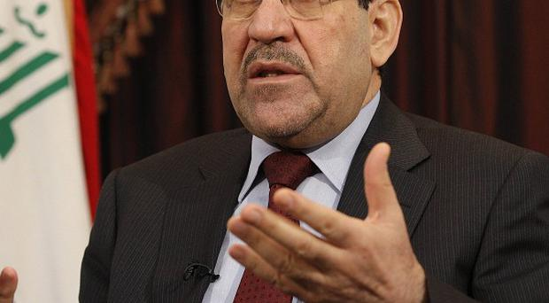 The siege in Mosul intensifies the pressure on Iraqi prime minister Nouri al-Maliki (AP)