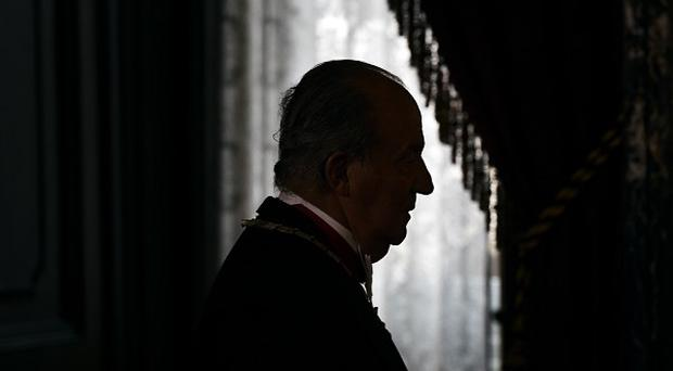 Spanish king Juan Carlos plans to abdicate and pave the way for his son, Crown Prince Felipe, to become the country's next king. (AP Photo/Daniel Ochoa de Olza, pool)