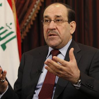 Iraqi prime minister Nouri al-Maliki has come under fire for his handling of the insurgency engulfing northern Iraq (AP)