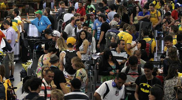Travellers face public transport strikes as the World Cup opens in Brazil (AP)