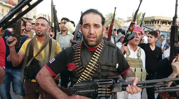 Iraqi Shiite tribal fighters yesterday vowed to oppose the insurgents in control of Mosul