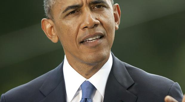 Barack Obama has announced plans to deploy up to 275 troops to Iraq (AP)