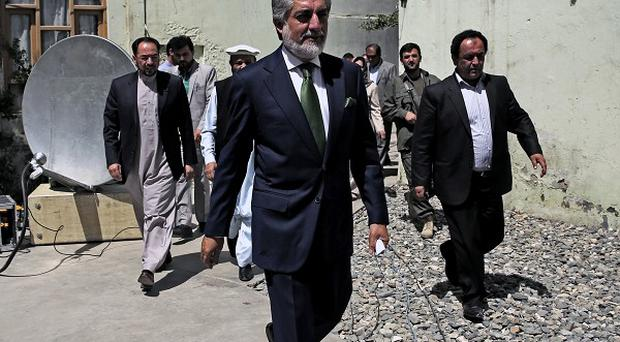 Afghanistan's presidential candidate Abdullah Abdullah arrives for a news conference in Kabul (AP)
