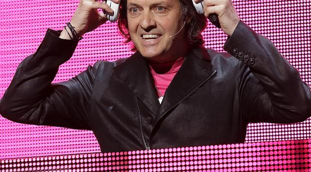 T-Mobile CEO John Legere puts on headphones before announcing the new streaming music service (AP)