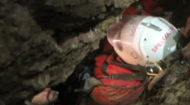This screenshot from a video provided by the Bavarian Mountain Rescue Service shows rescuers transporting cave explorer Johann Westhauser (AP/BRK Bergwacht Bayern)