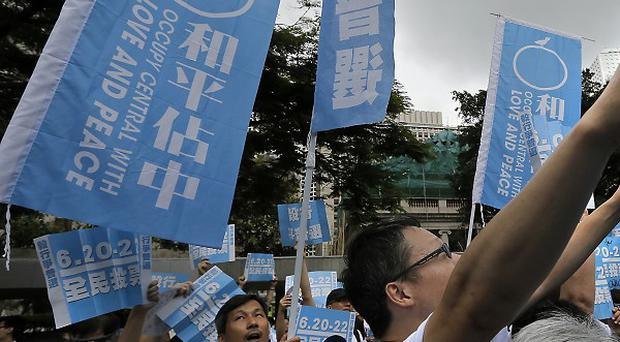 Pro-democracy supporters back an unofficial referendum on democracy in Hong Kong (AP)