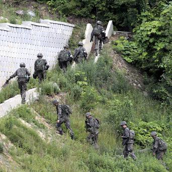 South Korean soldiers search for a conscript suspected of killing five comrades (AP)