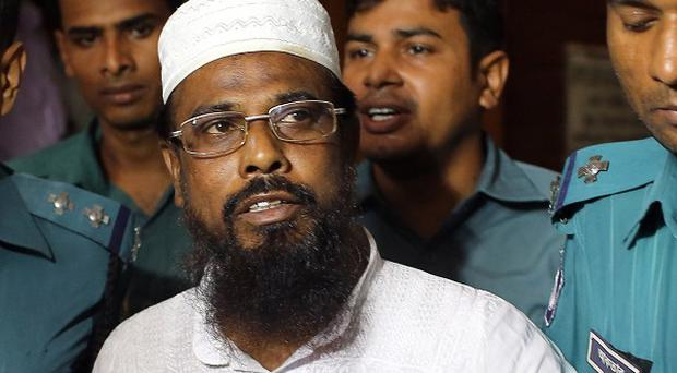 Mufti Abdul Hannan, leader of banned radical group Harkatul Jihad al Islami, in court in Dhaka (AP)